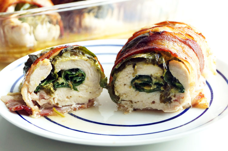 Chicken rolls stuffed with guacamole and leafy greens and wrapped in bacon. Paleo, AIP, low-carb. // TheCuriousCoconut.com