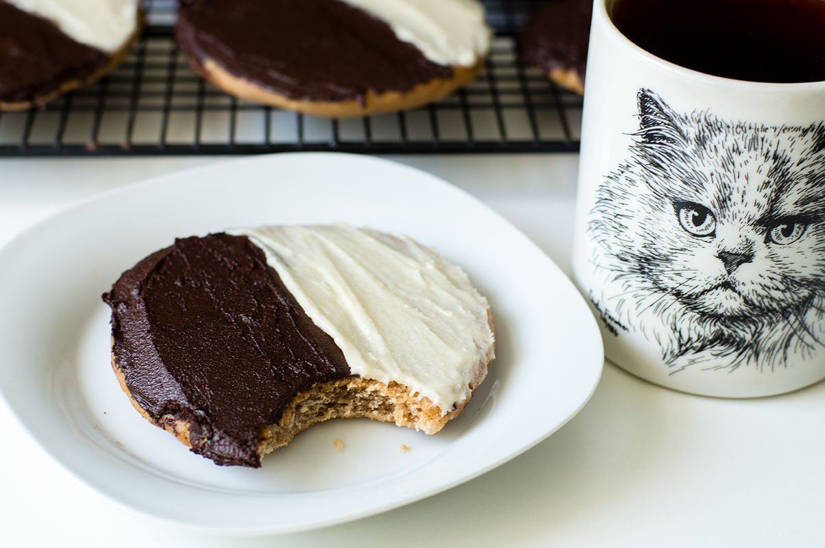 enjoy a black and white cookie with coffee