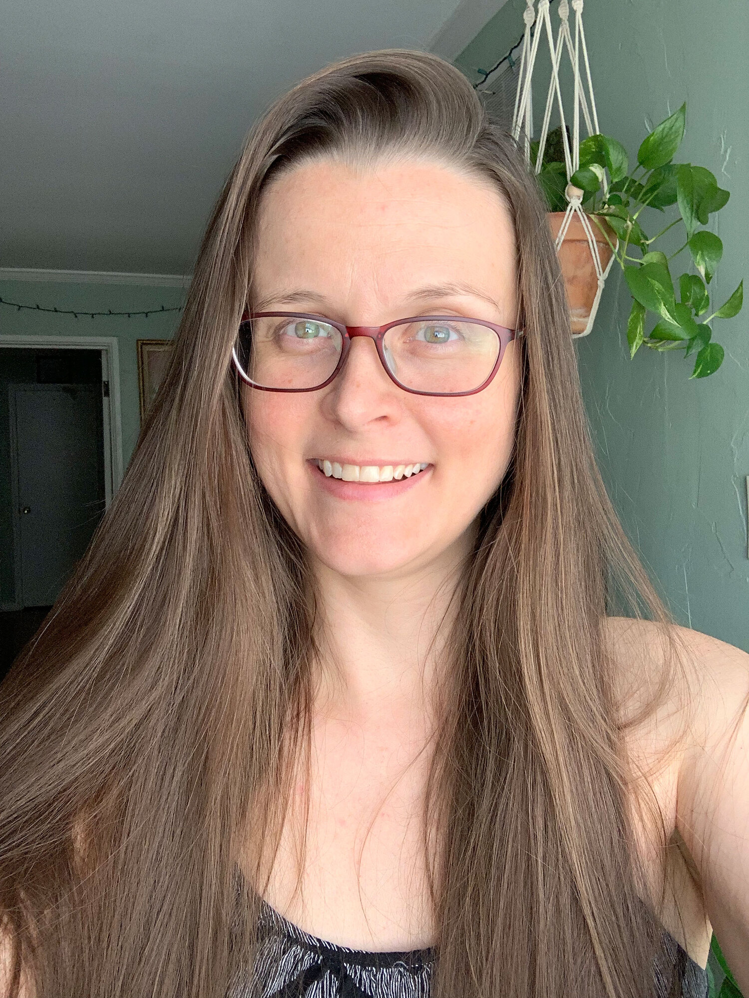 Fluffy, volume-packed hair by Innersense, clear glowing skin by Beautycounter and gua sha