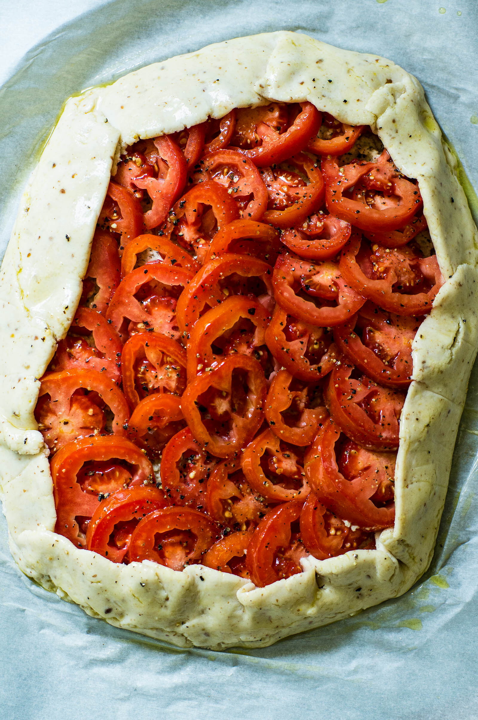 This easy tomato galette features a no-chill crust made Paleo and gluten-free with cassava flour, a quick no-soak vegan cashew garlic herb ricotta, and bold San Marzano tomatoes.