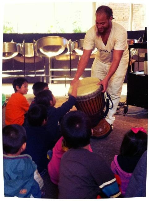 """Mikhail """"Fyah"""" Parson teaching about the Djembe drum"""