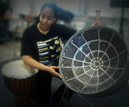 Suzette showing the  students the Spider Web Pan, whose design plus arrangement of notes in the circle of 5th's style were first introduced by Anthony Williams