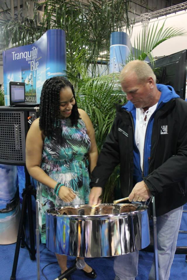 "VIP Night at the ""Eastern Caribbean Village"" for the Toronto International Boat Show. Home improvement contractor & television host Mike Holmes taking a knock on the steelpan with pannist Suzette Vidale"