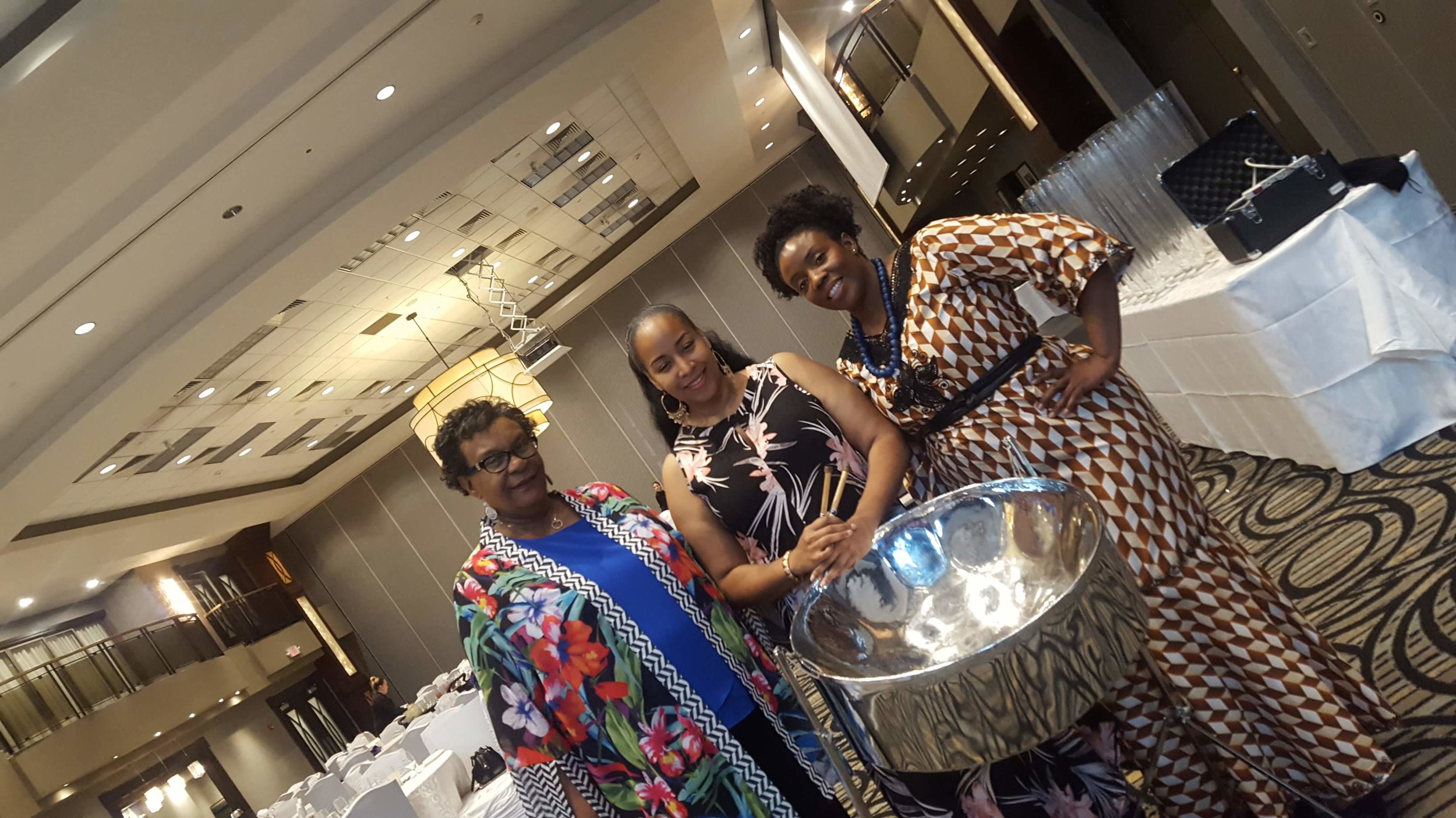 CBWC President Mariska  Thomas, Steelpannist Suzette Vidale & Spoken Word Artist Myrtle Sodhi-Afro quill