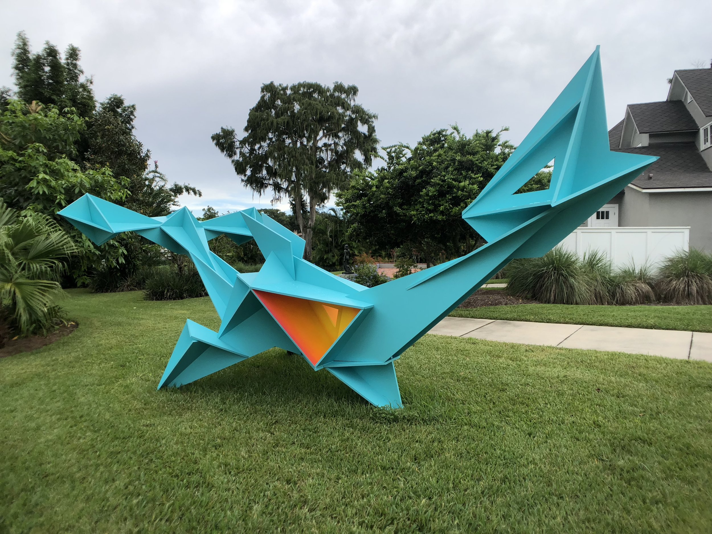 POINT SHIP, Plywood (Aqua-colored triangular, outdoor sculpture in back gardens)
