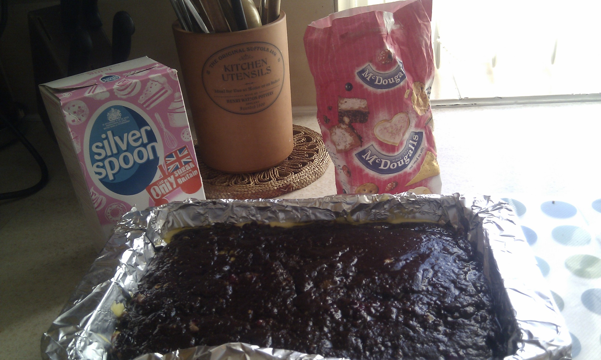 Chocolate ginger brownies with blueberries bits read for the oven. The kitchen was not always this tidy