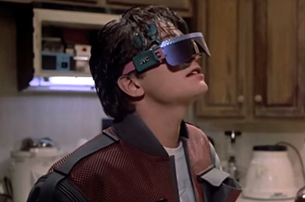 Marty McFly Jr getting a taste of virtual reality in Back to the Future Part II, set in the year 2015 as imagined in 1989. The product design turned out a little better, thankfully