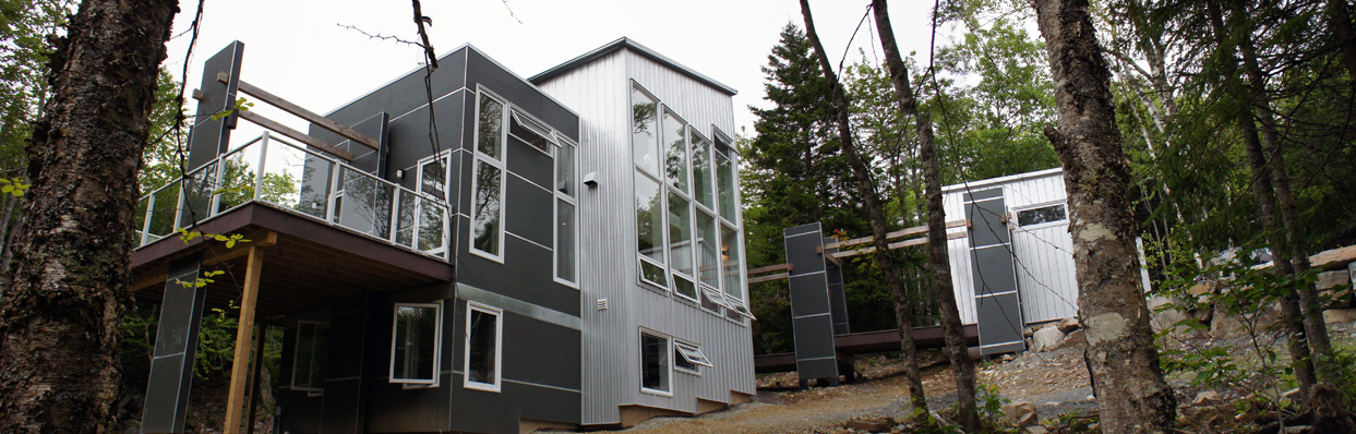 Southwest elevation. South facing windows will provide passive solar heat through the winter and careful placement of operable windows give ample natural ventilation during warm months