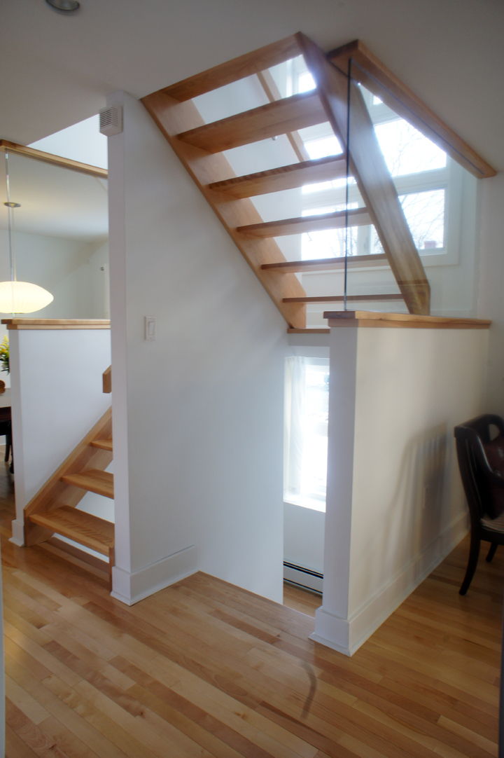 The beautifully crafted open riser stair is the centerpiece of the renovation and is also the first thing you see on entering