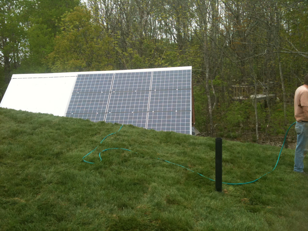 View of the shed solar panels from the main house living roof