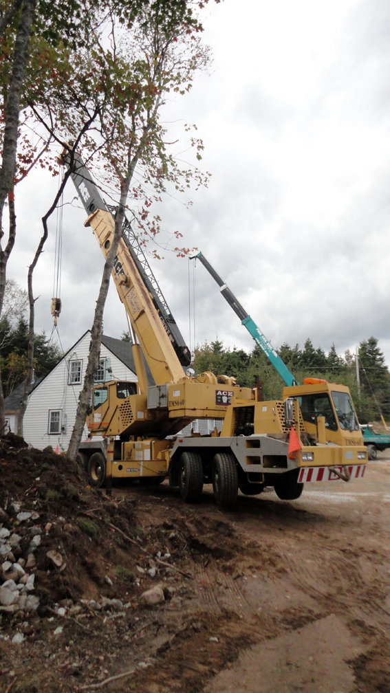 two large cranes were used to place the house