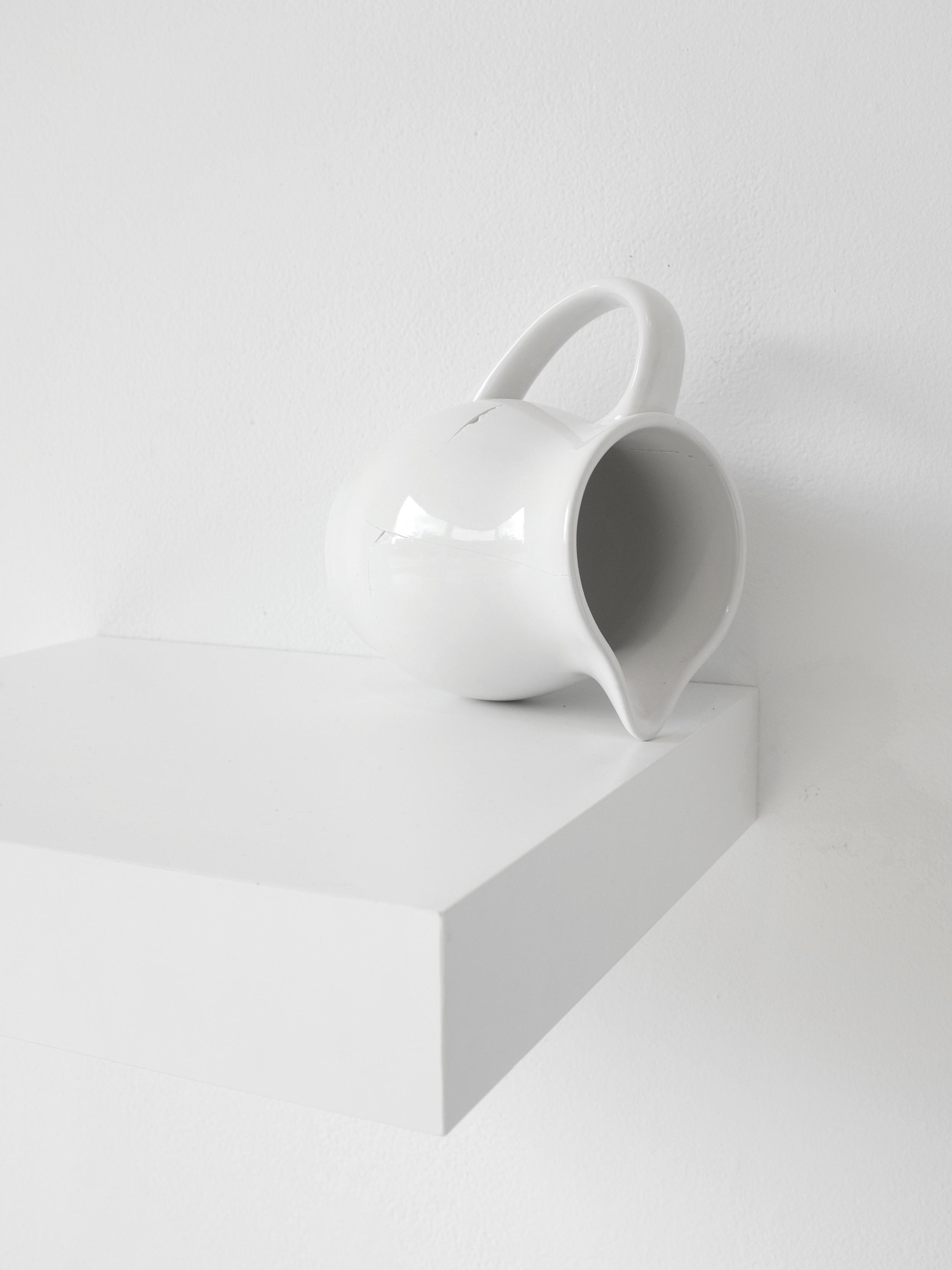 "Installation of milk pitcher (found), broken and fixed, 5""x4"", 2015 (detail)"