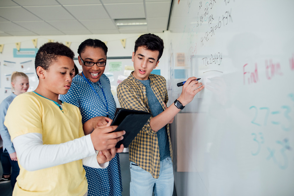 Students at Chalkboard