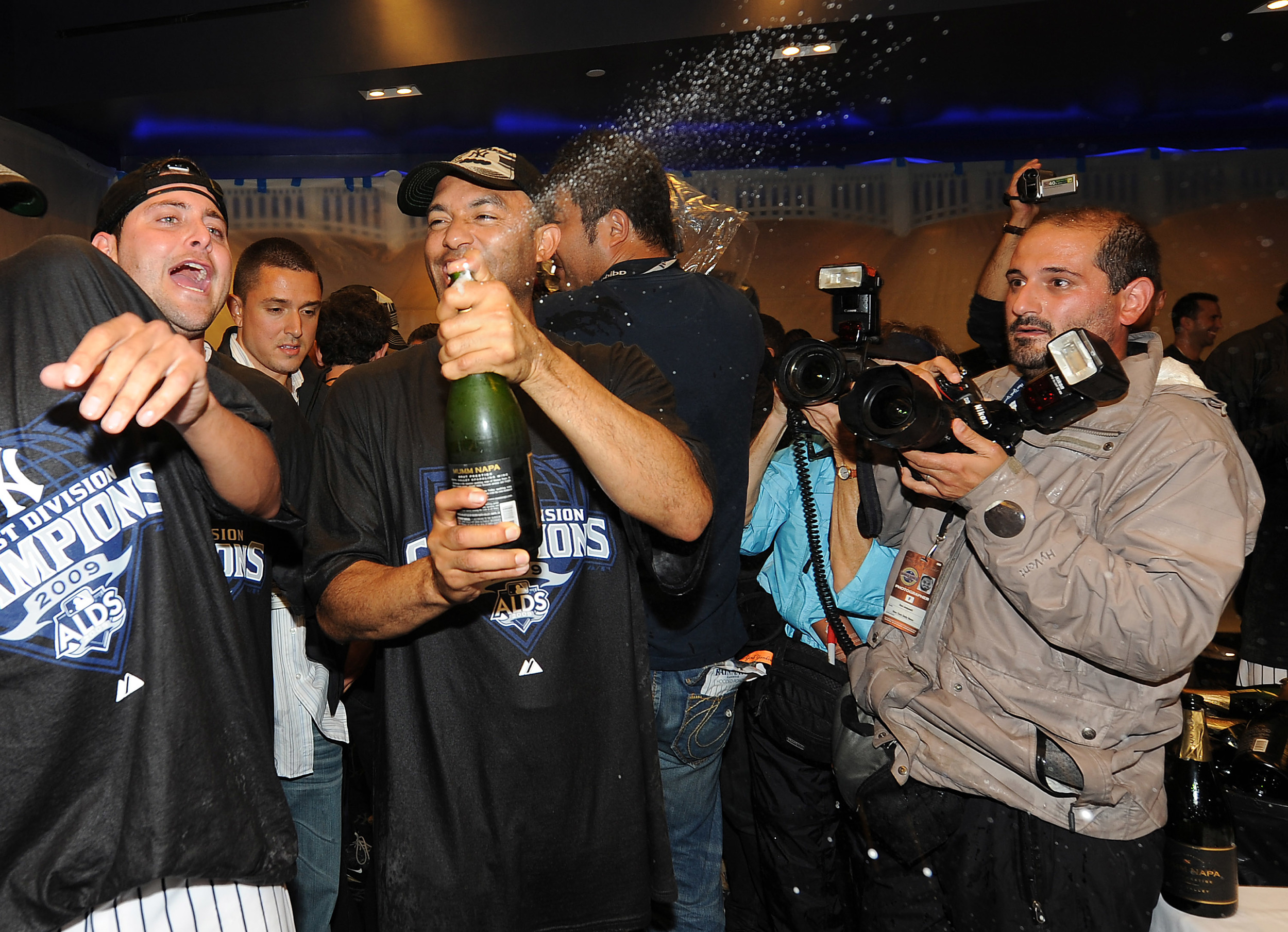 The rather awkward looking photographer at right is me, next to Mariano Rivera as he pops the cork of a champagne bottle in the clubhouse.