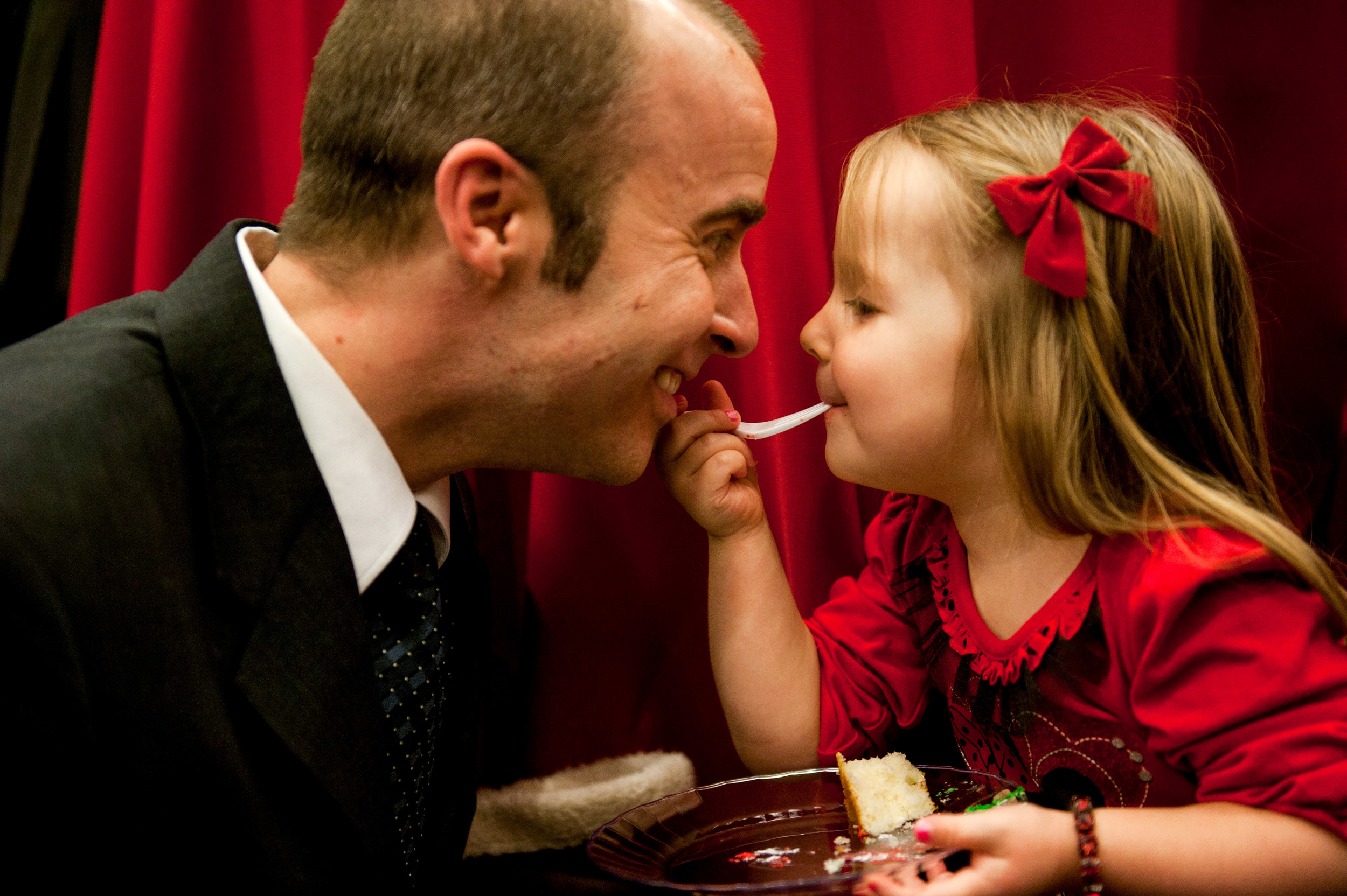 Natalie and Lance Schloot share a piece of cake at the Triangle Father Daughter Dance in Raleigh, N.C. on Saturday February 2, 2013.