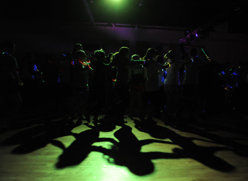 Students dance in a long conga line during the UNC Dance Marathon in Fetzer Gym at UNC Chapel Hill on Saturday, February 16, 2013.