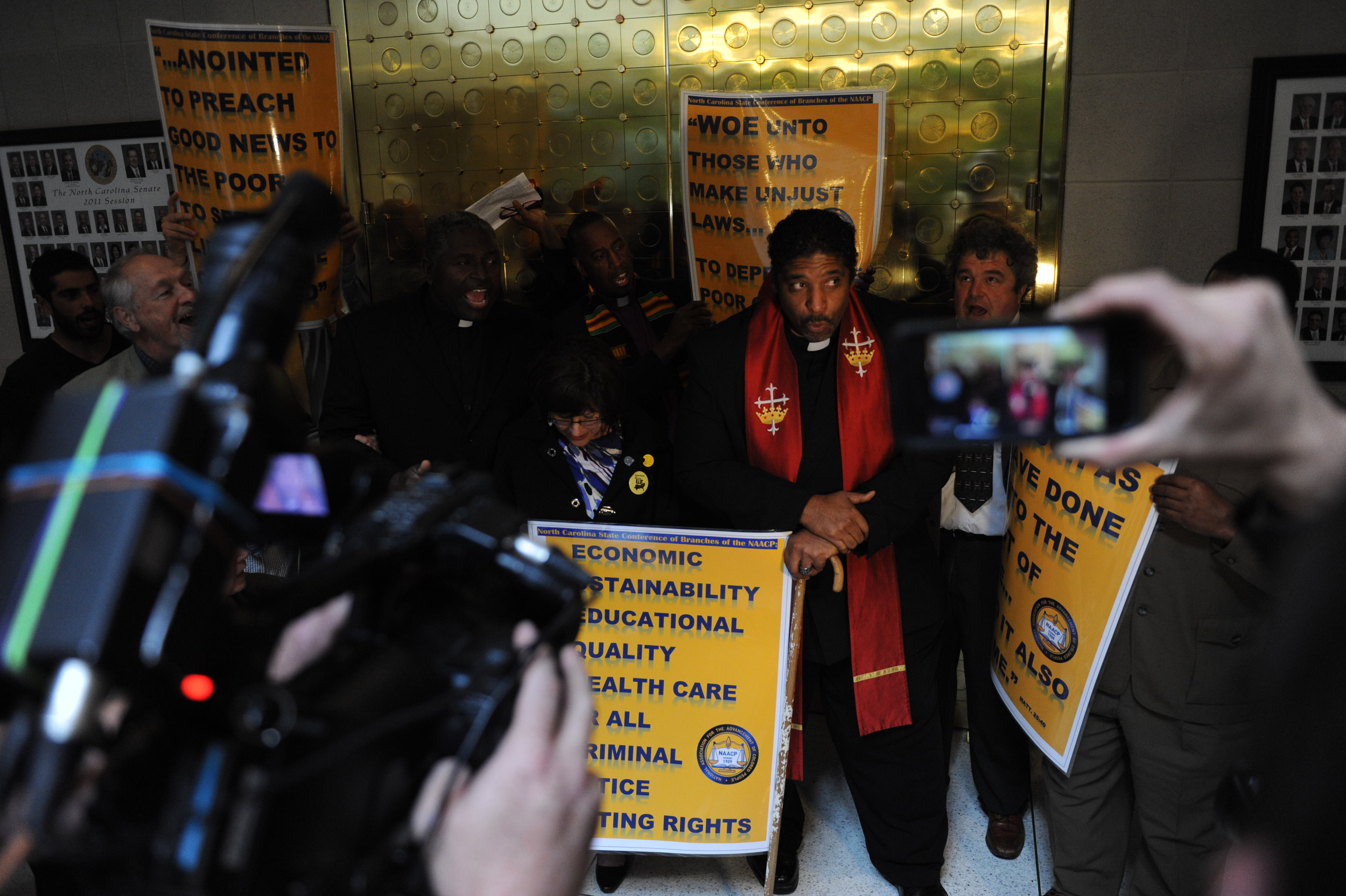 During an act of civil disobedience condemning the Republican legislature's agenda Monday, April 29, 2013, outside the N.C. Senate chamber, seventeen people including N.C. NAACP President Rev. William Barber were arrested.