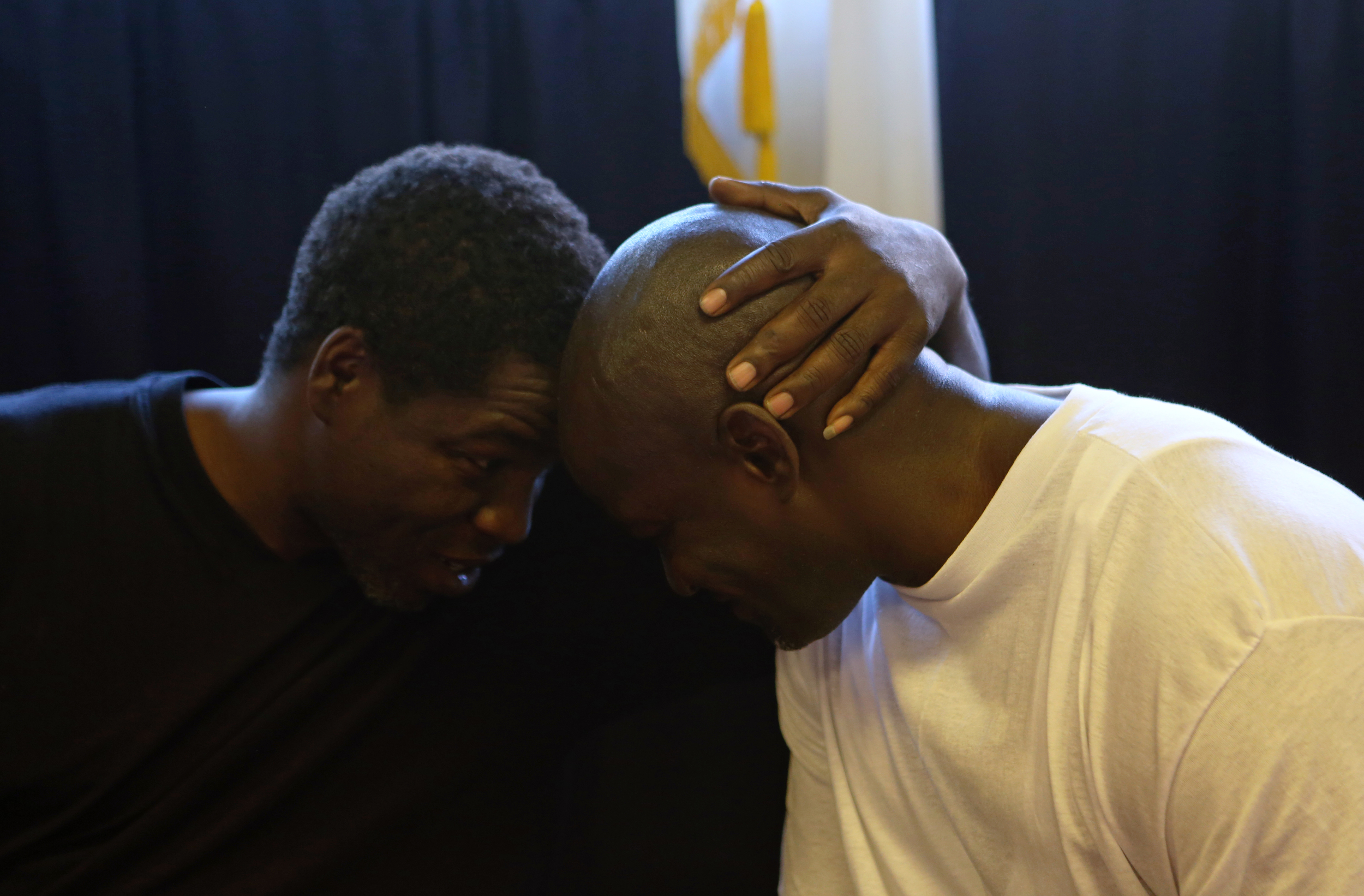 Daniel Taylor, right, shares a quiet moment with his brother, David while he eats his first meal out of prison at Jodie's Ol' Farmhouse Cafe & Bakery in Mernard, Ill. on Friday June 28, 2013. Daniel was wrongly convicted of murder nearly 20 years ago.