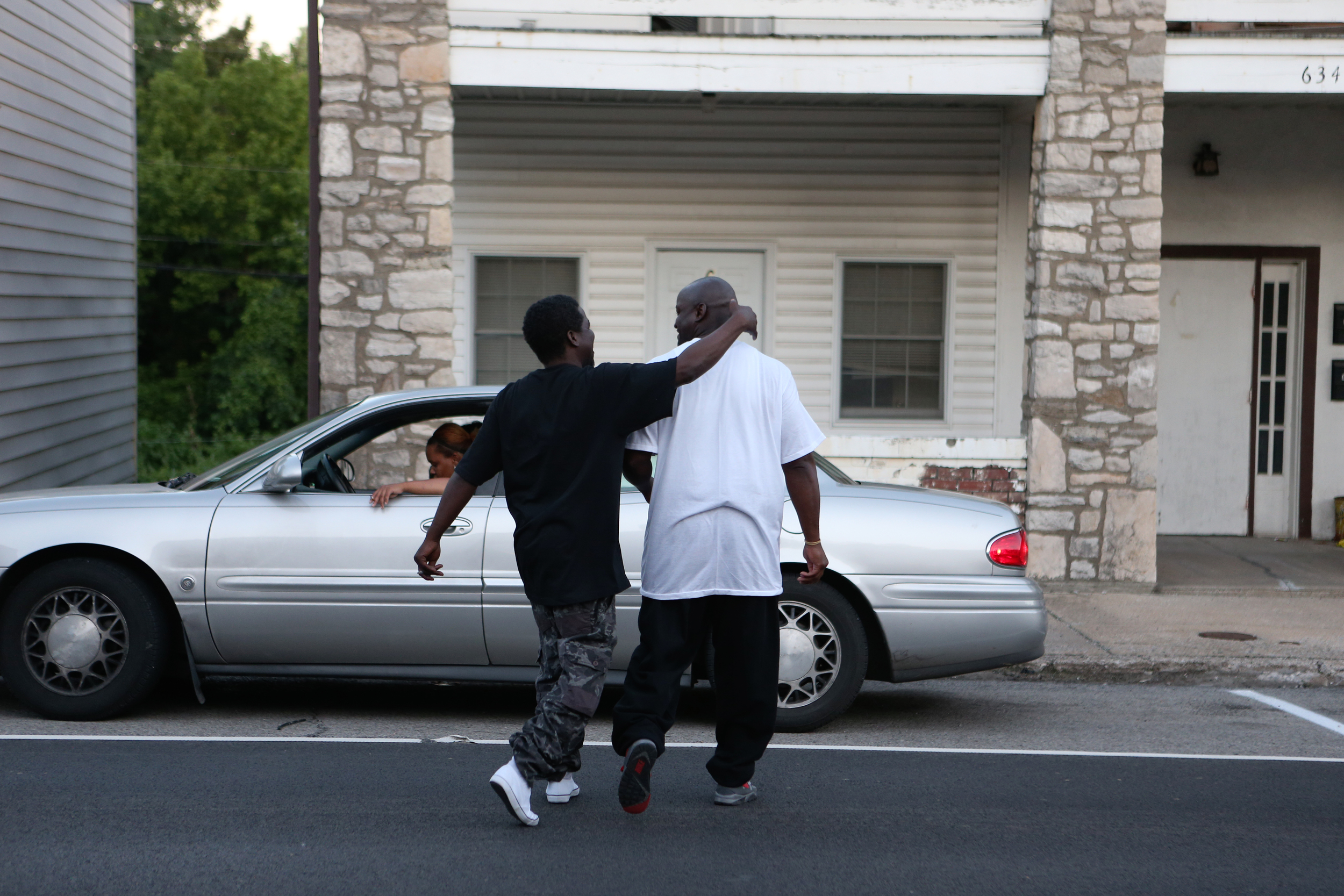 Just hours after his release, Daniel walks with his brother, David, out of Jodie's Ol' Farmhouse Cafe & Bakery in Mernard, Ill. on Friday June 28, 2013. They were heading home to David's house in Chicago, where Daniel will live until he gets his own place.