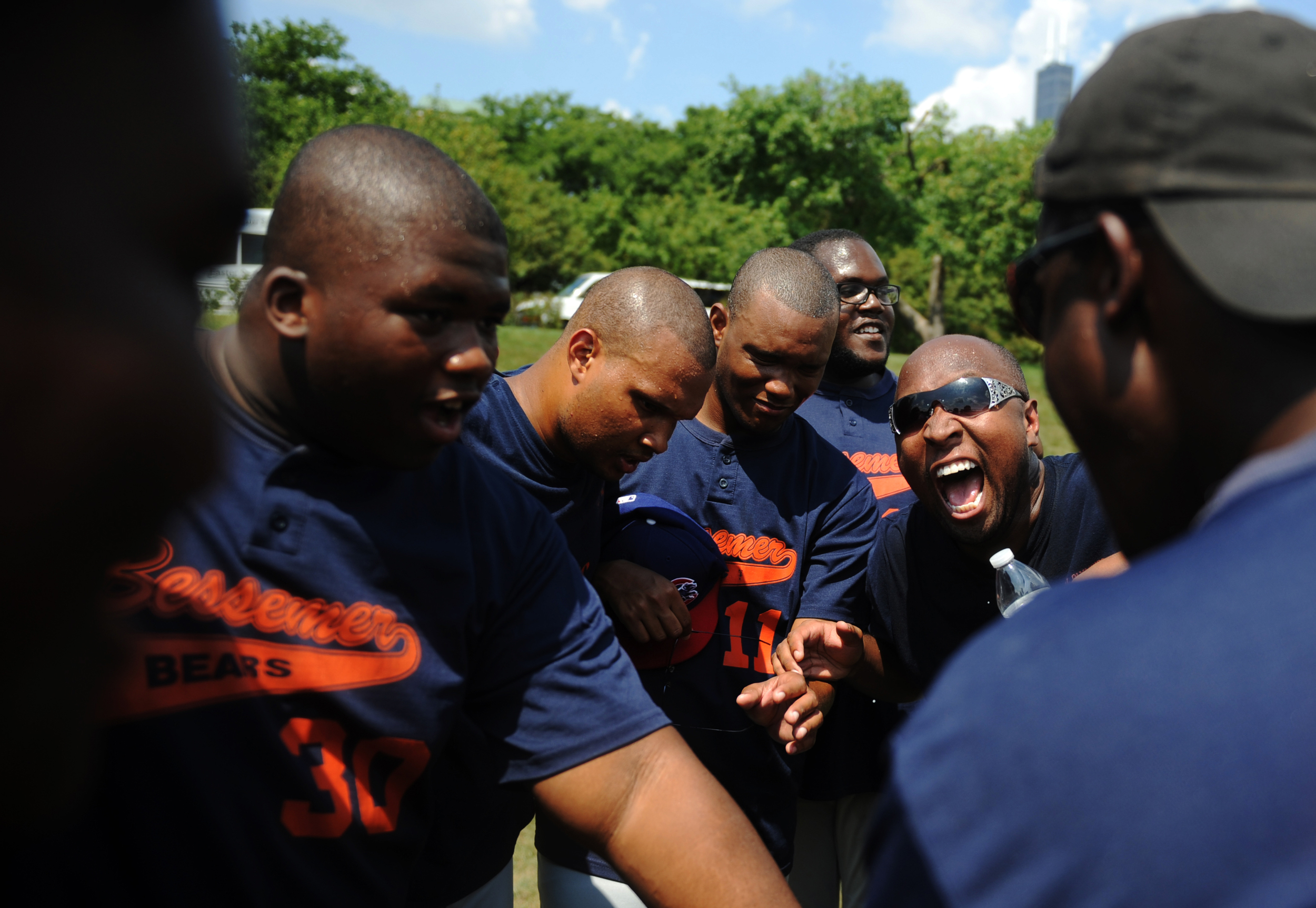 Members of the Bessemer Bears team gather after winning their game at the 45th Anniversary of the Chicago Special Olympics held in Grant Park on Thursday, July 18, 2013.