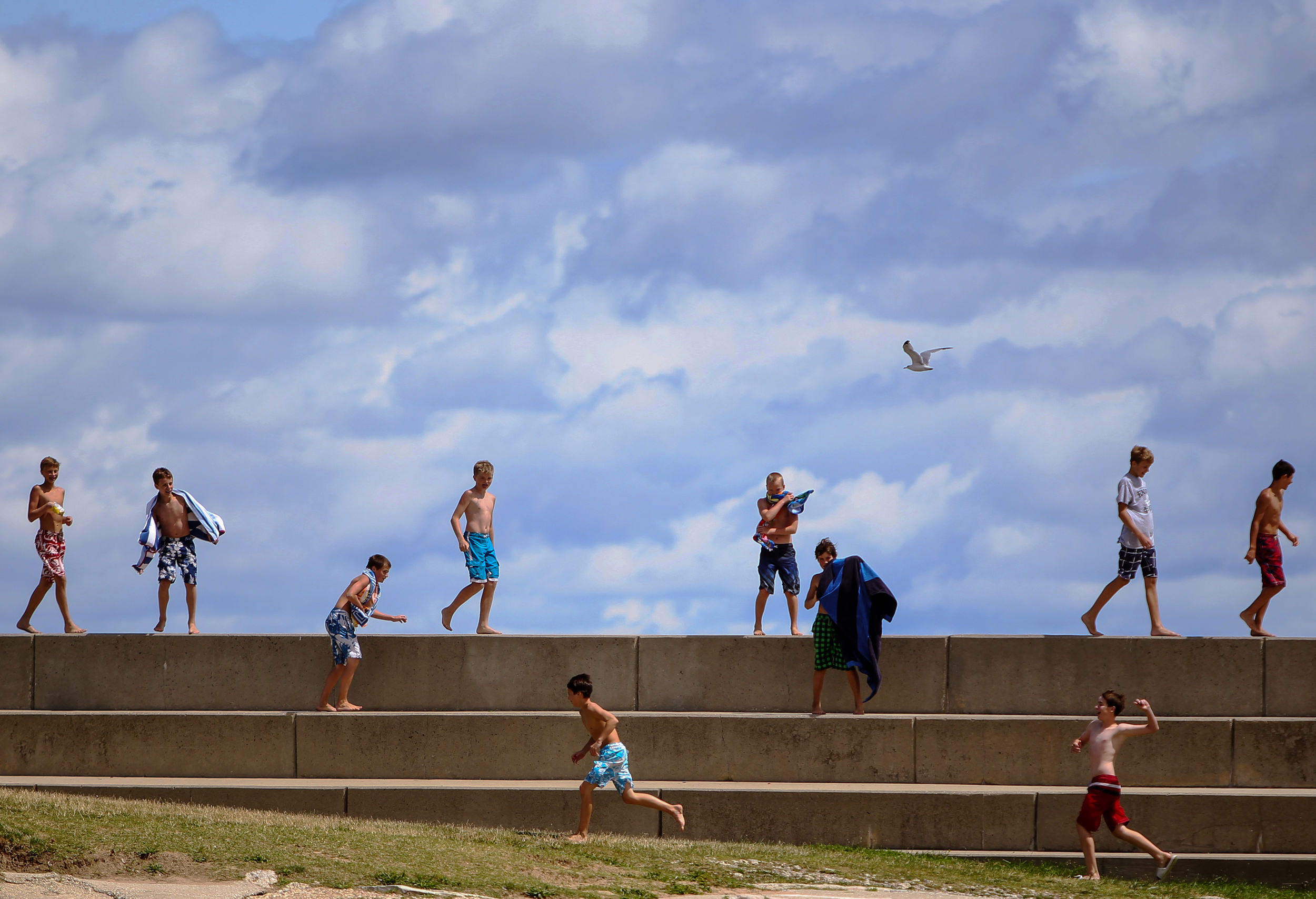 Children play along the 12th Street Beach in Chicago on August 13, 2013.  Lifeguards had told them to get out of Lake Michigan because of rip tides and high levels of e. coli.