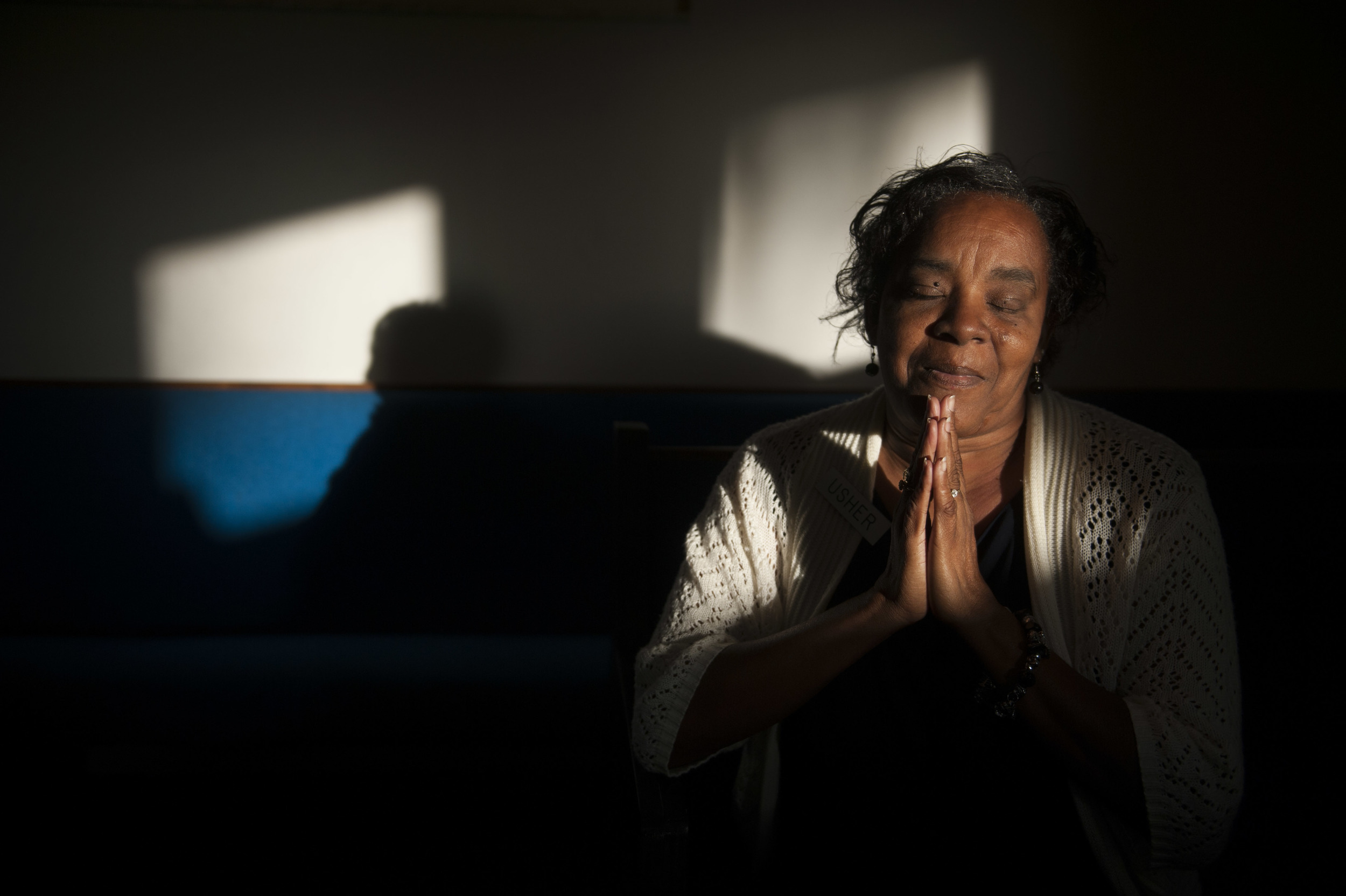 Deborah Barr, 56, sits for a portrait after service at the Israel Bethel P.B. Church in Tampa on Sunday, November 17, 2013. Barr, who is unable to read, carries a bible in her purse and is hoping to one day be able to read it. Her story is a part of the Holiday Hopes series in which the Tampa Bay Times features the stories of those in need during the holiday season. Readers are encouraged to reach out to the subjects of these stories with support and assistance.    The video, gallery, and story can be found here: http://www.tampabay.com/news/humaninterest/woman-yearns-for-a-simple-holiday-wish-to-learn-to-read-her-bible/2154825