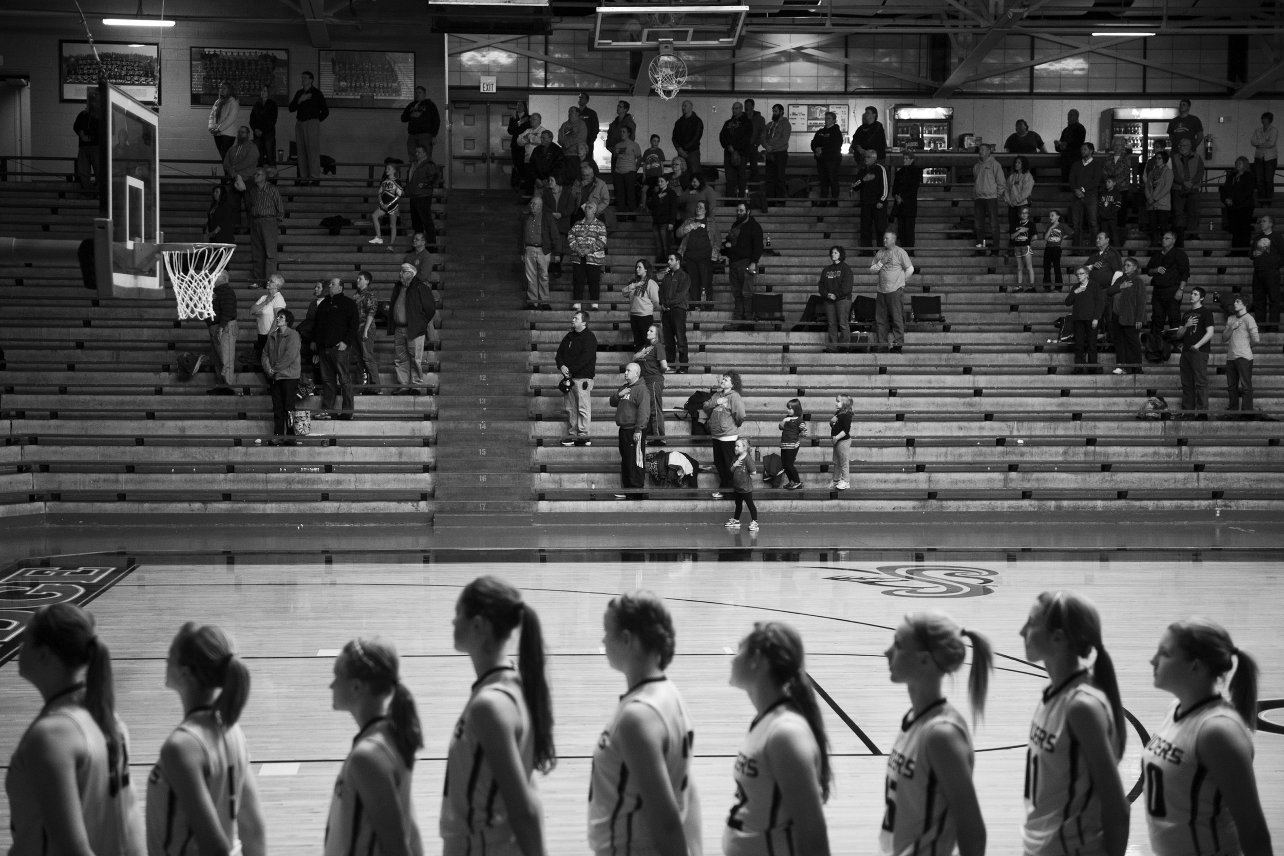 The crowd and Southridge's Lady Raiders stood for the national anthem before the game Thursday. Southridge defeated South Spencer 51-20 at Memorial Gym in Huntingburg.