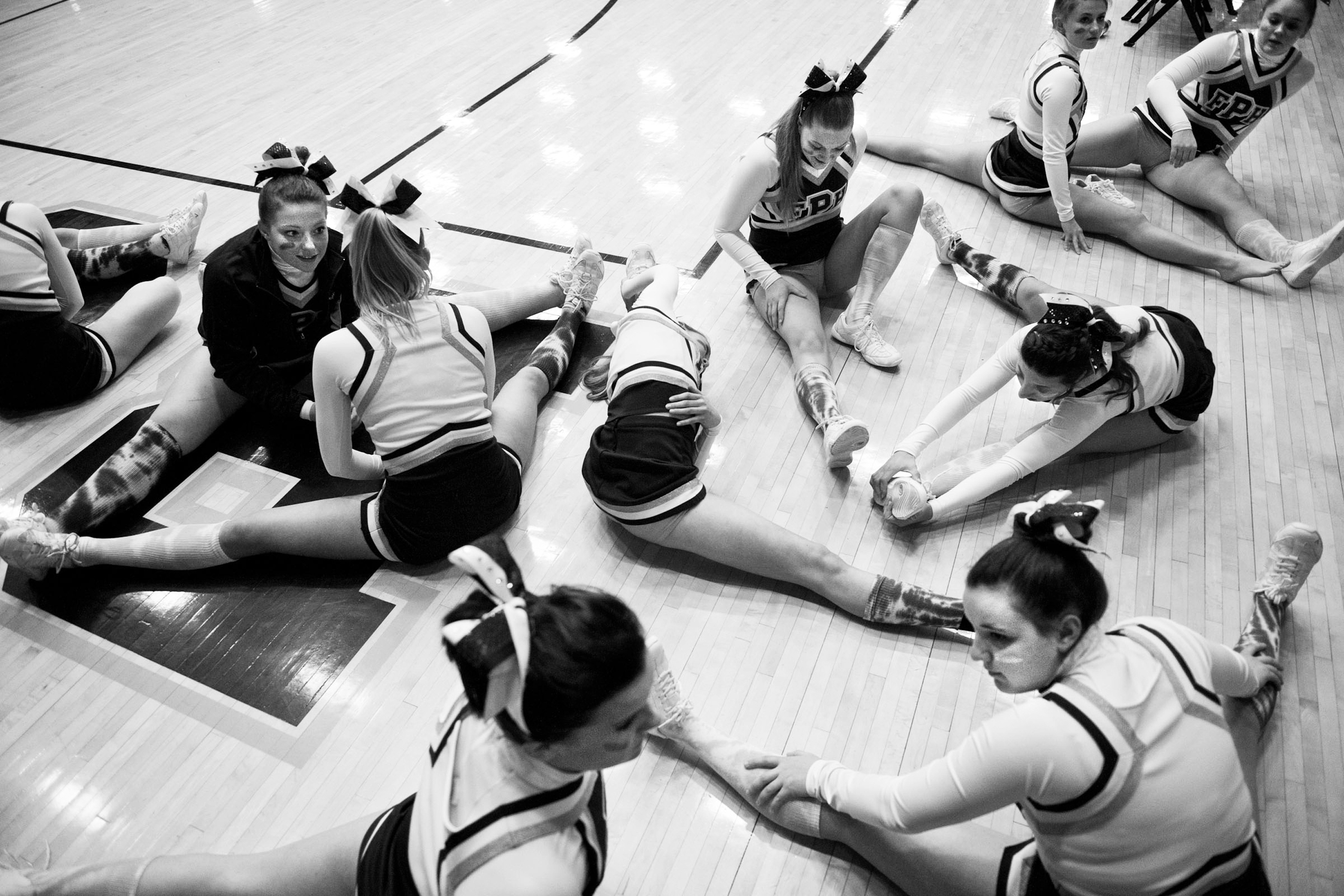 Forest Park's varsity cheerleading squad stretched before the game against Mater Dei in the IHSAA Class 2A sectional tournament in Boonville on Friday. The Rangers lost 68-57.