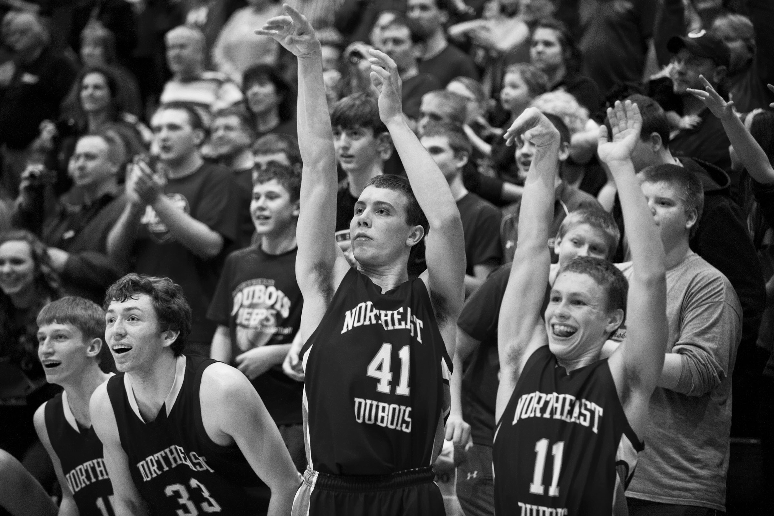The Jeeps' Tyler Haas, left, Jacob Gress and Tristan Linne made a shooting motion from the bench just seconds before winning the IHSAA Class 1A sectional tournament against Tecumseh in Lynnville on Saturday. Northeast Dubois won 55-45.