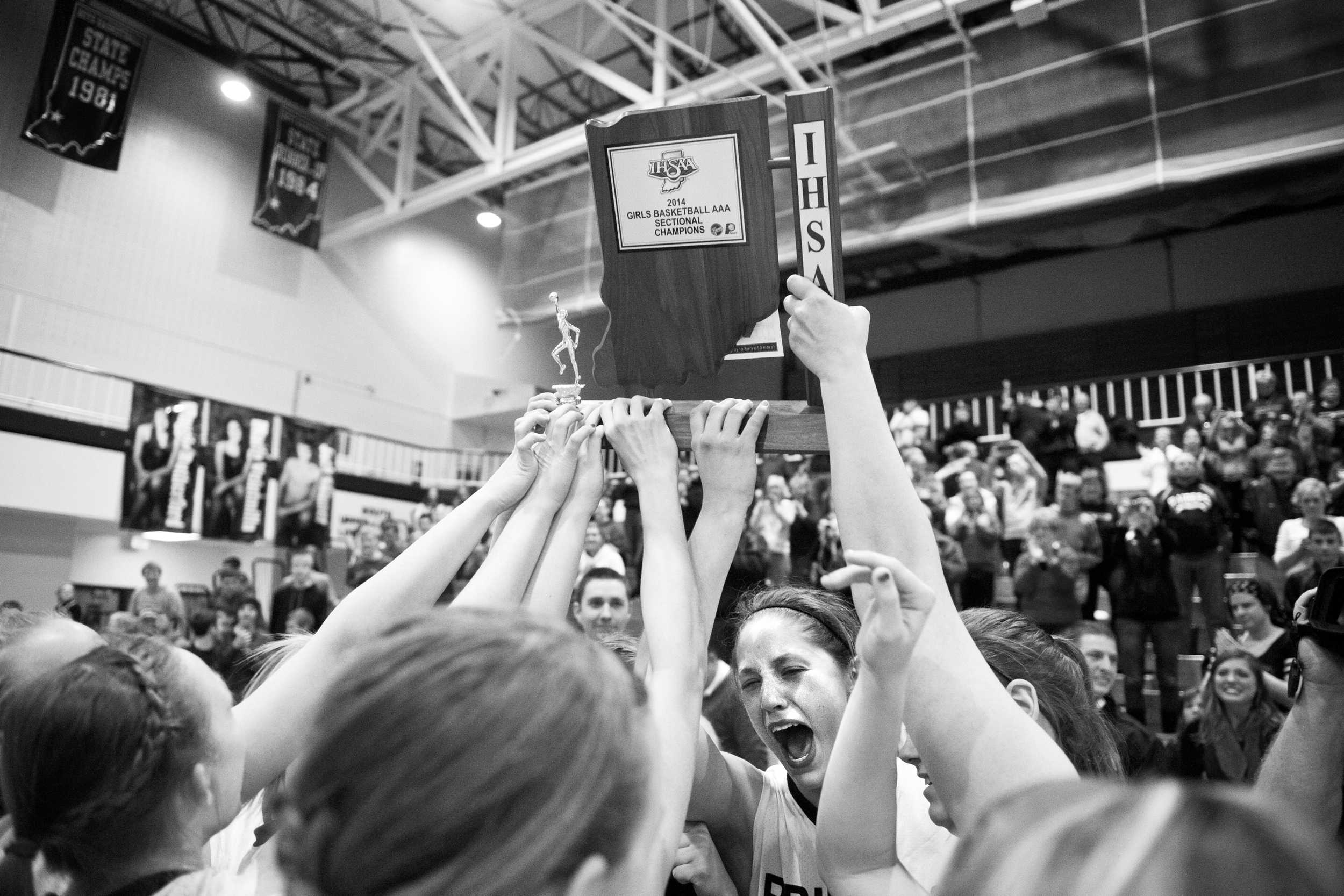The Southridge Raiders hoisted their trophy up after winning the Class 3A girls basketball sectional championship at Alice Arena in Vincennes on Saturday. Southridge defeated Vincennes 46-41.