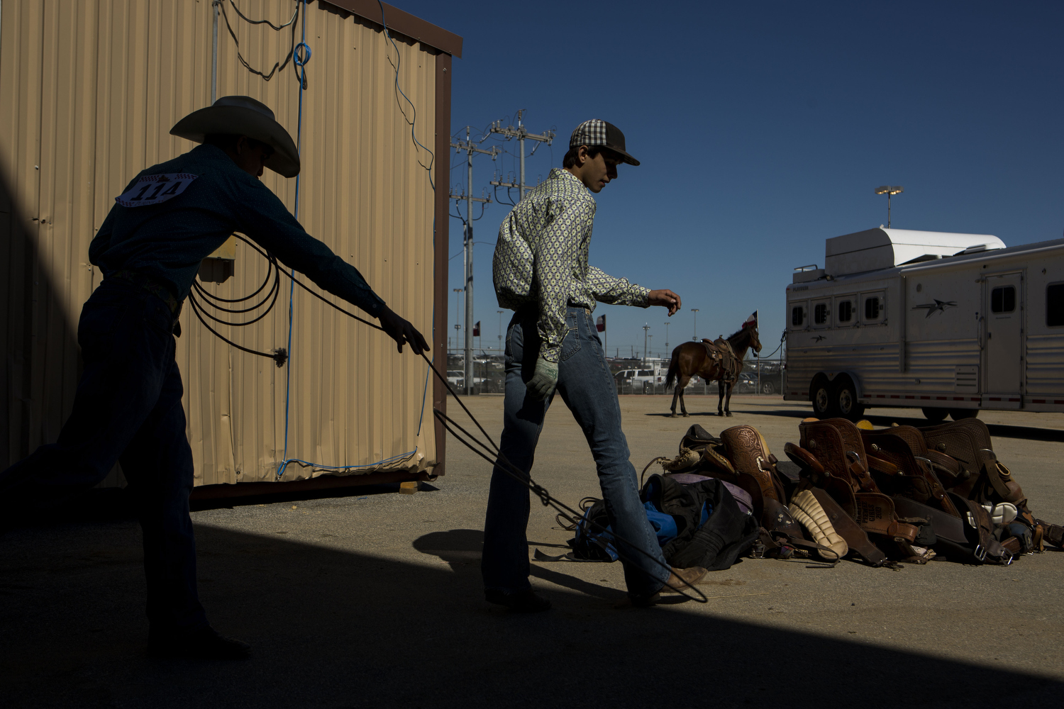 Cash Fretwell practices roping on his friend Brice Bauer's feet at the San Antonio Stock Show and Rodeo in San Antonio, TX on Wednesday, February 18, 2015.  They both are 14 and from Pleasanton, TX.