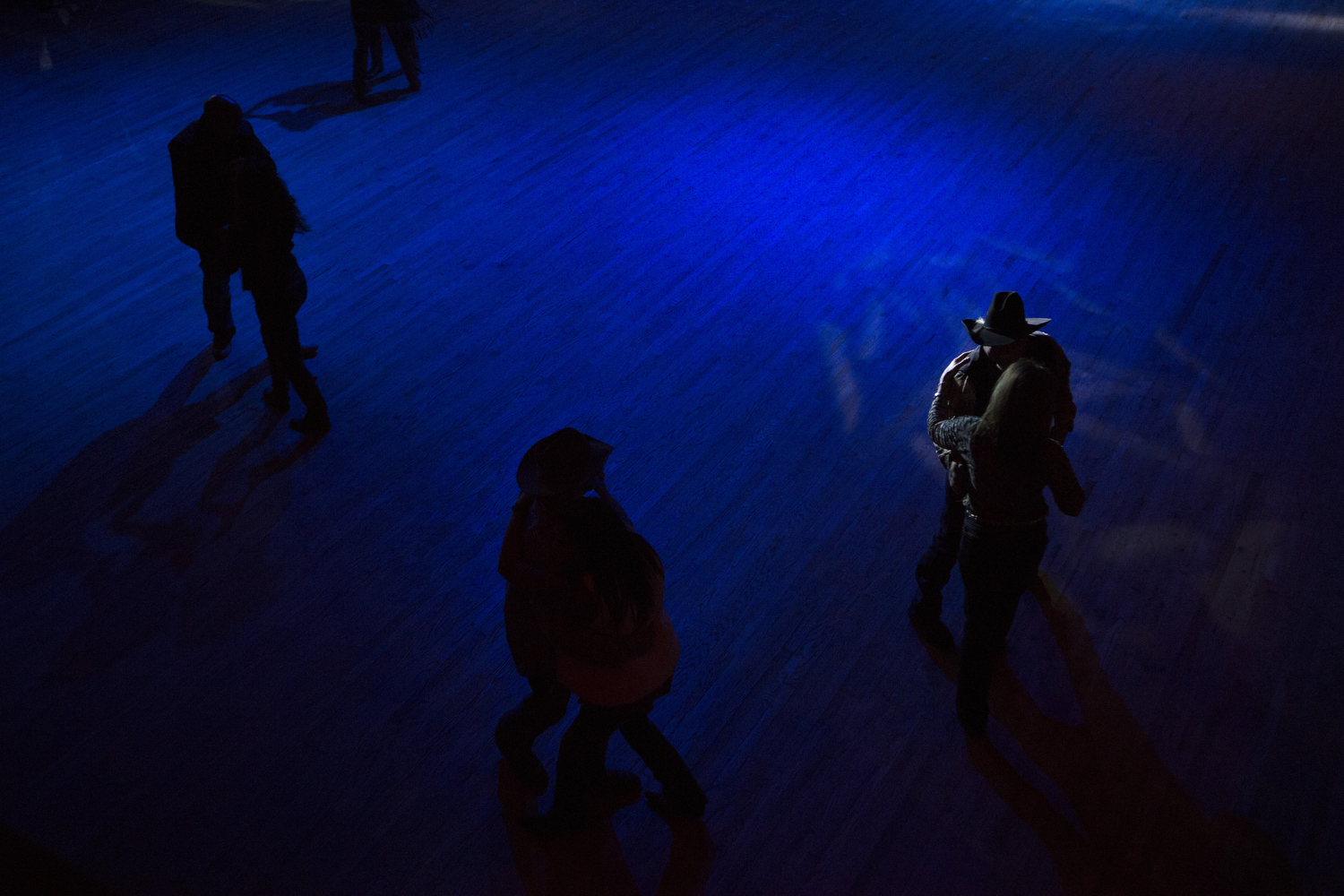 Several people dance to a live country music performance by the Sunset Riders at the Cowboy Dance Hall in San Antonio, TX on Friday, January 30, 2015 after the annual Cowboy Breakfast.