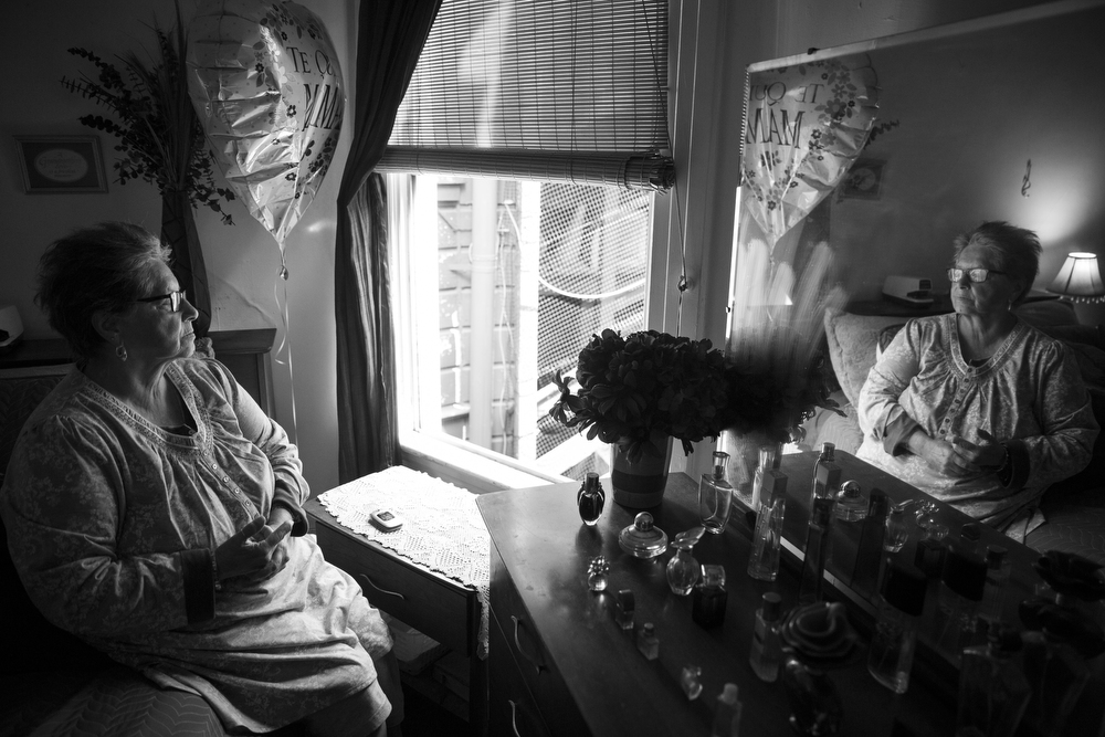 "Sylvia Smith poses for a portrait in her bedroom in her Mission neighborhood apartment in San Francisco, Calif. on June 2, 2015.  Smith has lived in the apartment for 41 years, but suddenly in the last year her landlord, Anna Swain, has begun threatening her with eviction.  Swain accused Smith of running a ""1-800-SEX-TALK"" operation and of selling drugs out of the apartment.  Of the accusations, she said, ""I don't even remember how to have sex!"" These threats have been the source of a wrongful eviction lawsuit against Swain.  Smith, 72, lives in the apartment with her grandson.  ""When I moved here, I paid $60 a month,"" Smith said.  ""Now she wants $5,000. I cry in my apartment all day.  I do not cry because I am sad.  I cry because I am so angry.""  Her apartment has exposed wires, nails, uneven floors and soiled carpets.  ""My doctor wants to put me in the hospital for two weeks, because I have panic attacks from the stress of this that he thinks could lead to a heart attack,"" she said."