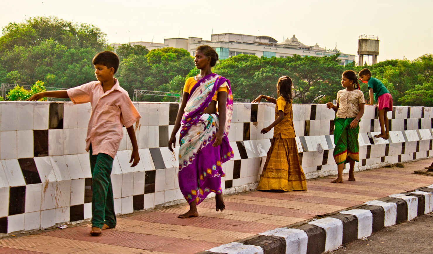 A generational family walks across the main bridge in Chennai