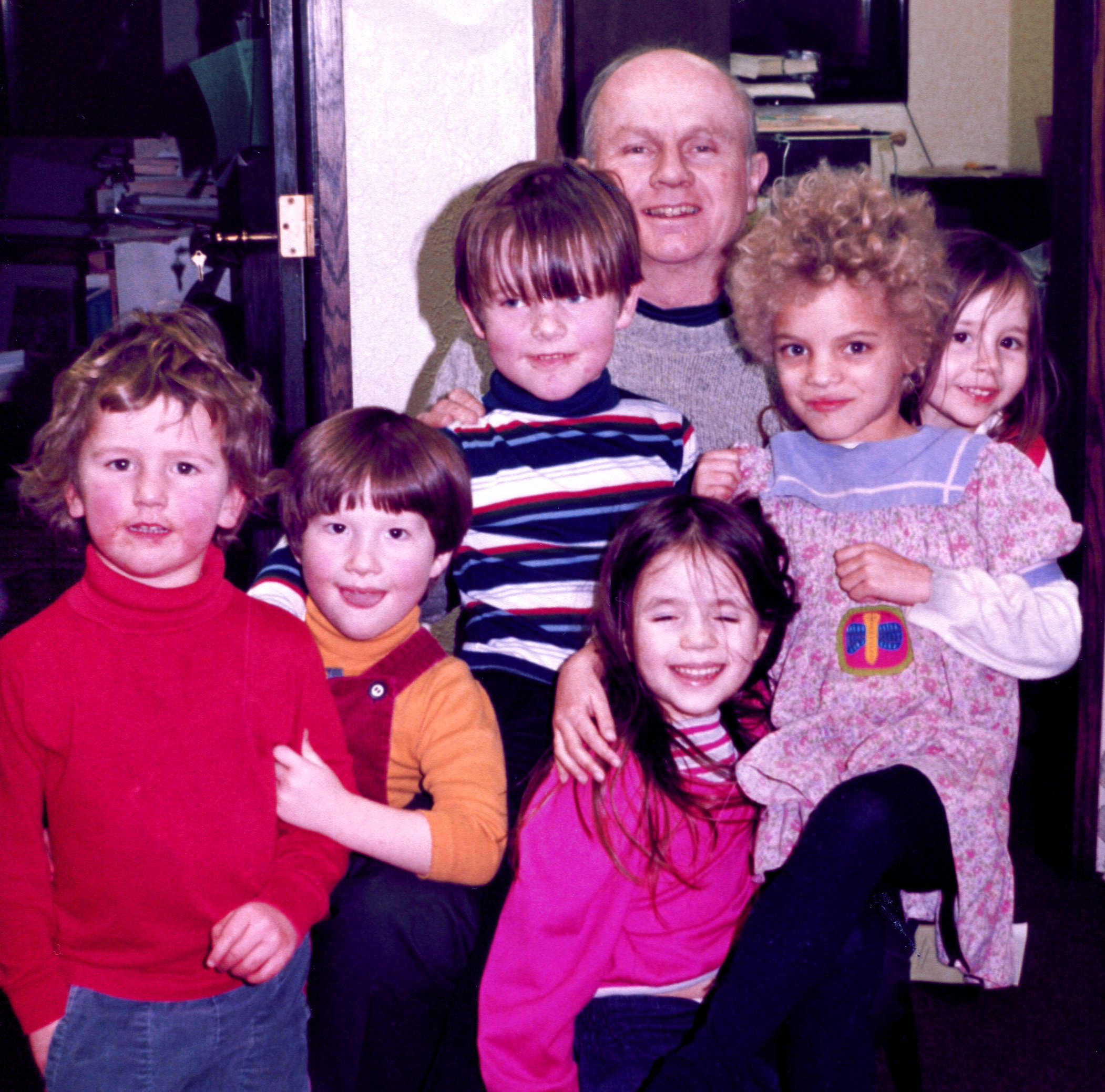 John Holt with children who came to the office with their volunteer parents.  From left to right: Joshua Gray, Solon Sadoway, Chris Gray, Danette Finn, as-yet unidentified child (anyone know who she is?), and Bridget Finn. Photo taken by Maggie Sadoway.