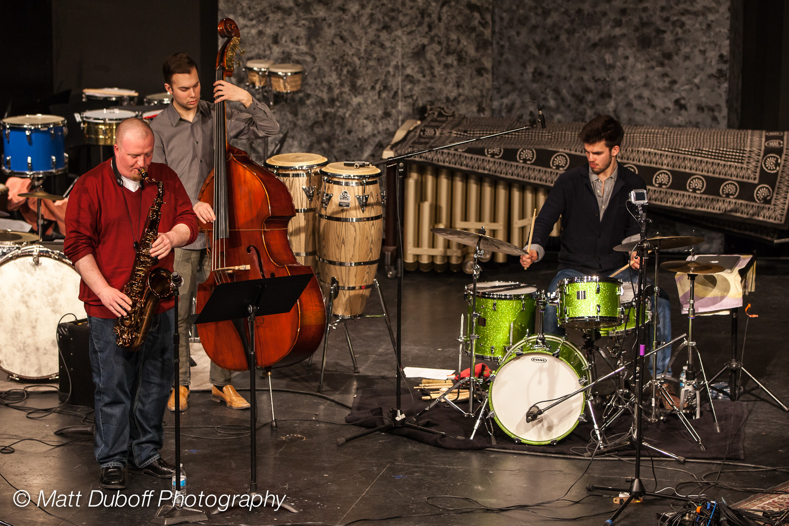 Lucas Sader ,  Paul Balcain , and  Karl Kohut  performing at the    2014 Winnipeg DrumTalk Festival   . Photo credit:  Matt Duboff .