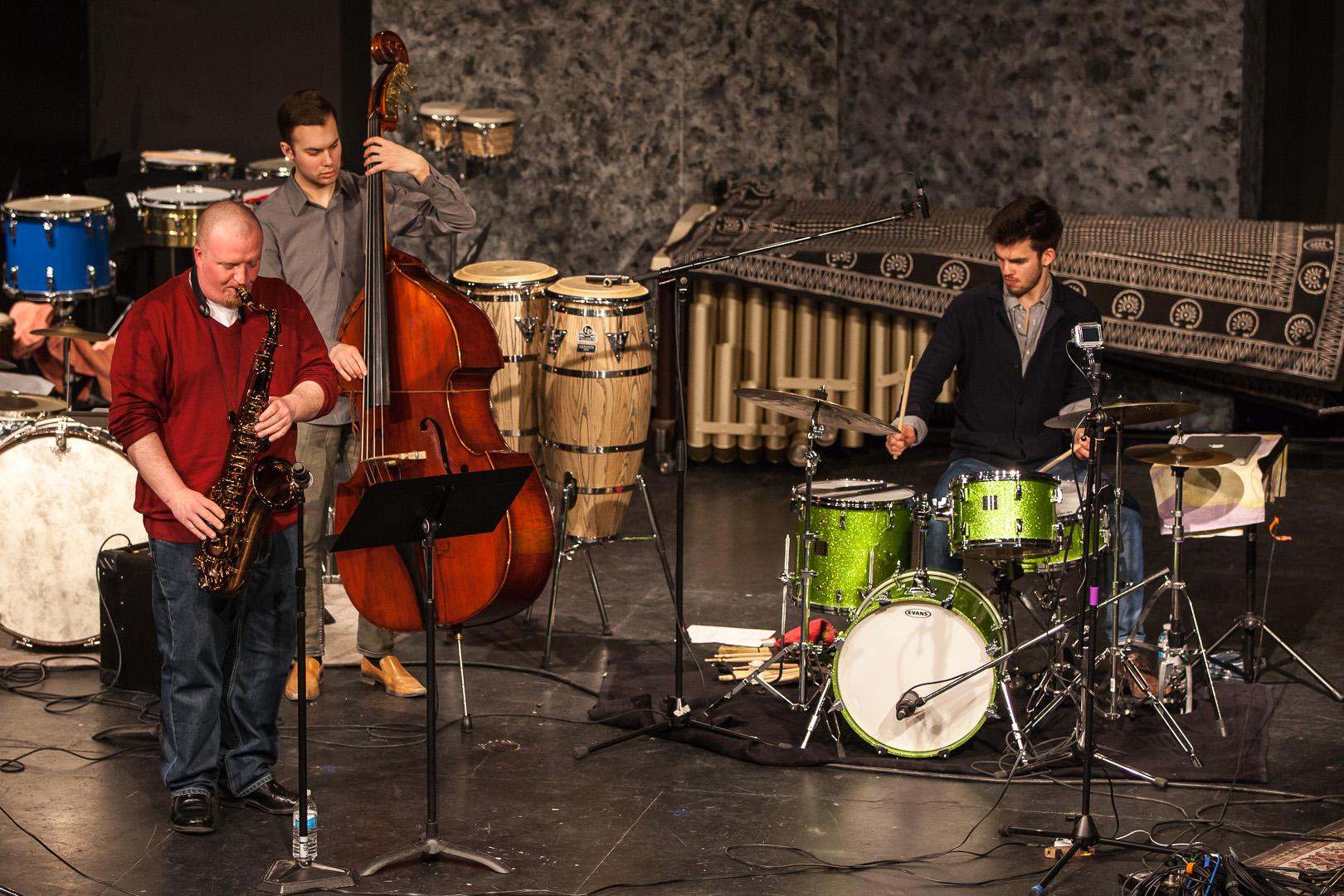 Lucas Sader  performing with  Paul Balcain  and  Karl Kohut  at the  2014 Winnipeg DrumTalk Festival . Photo credit:  Matt Duboff .