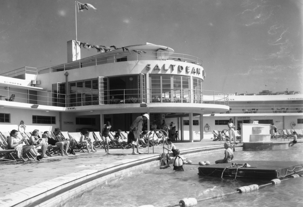 Circa 1938, when Saltdean Lido opened for the first time. Note the neon-lit, deco lettering above the rotunda. This sign was taken down and lost during the Second World War, as were many signposts on flight paths to London. As part of our restoration works, this sign will be re-created - Photo copyright RIBA