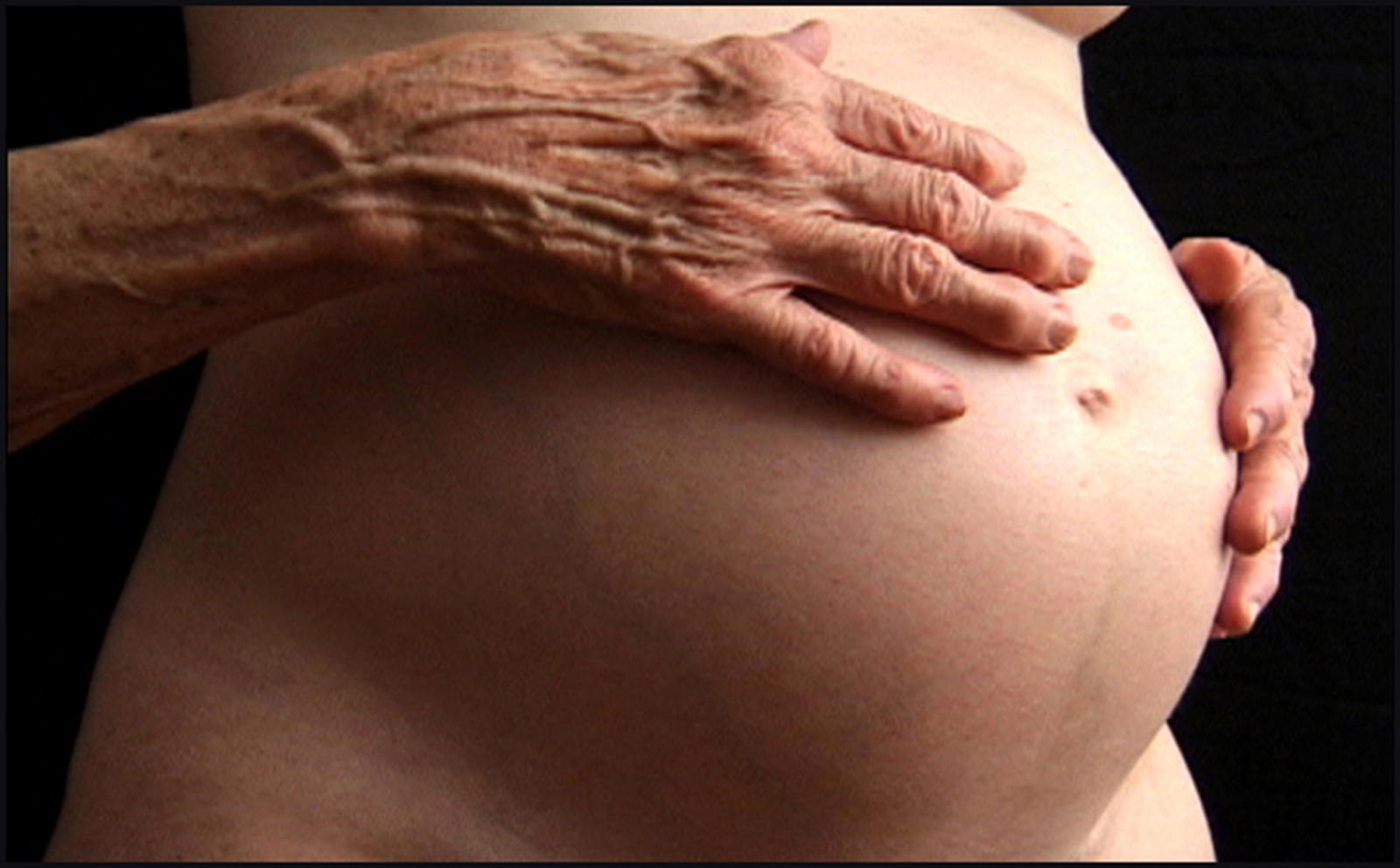 IoP Film-still, Mom's hands on Amy's belly, 300 dpi_©Amy Jenkins 2018.jpg