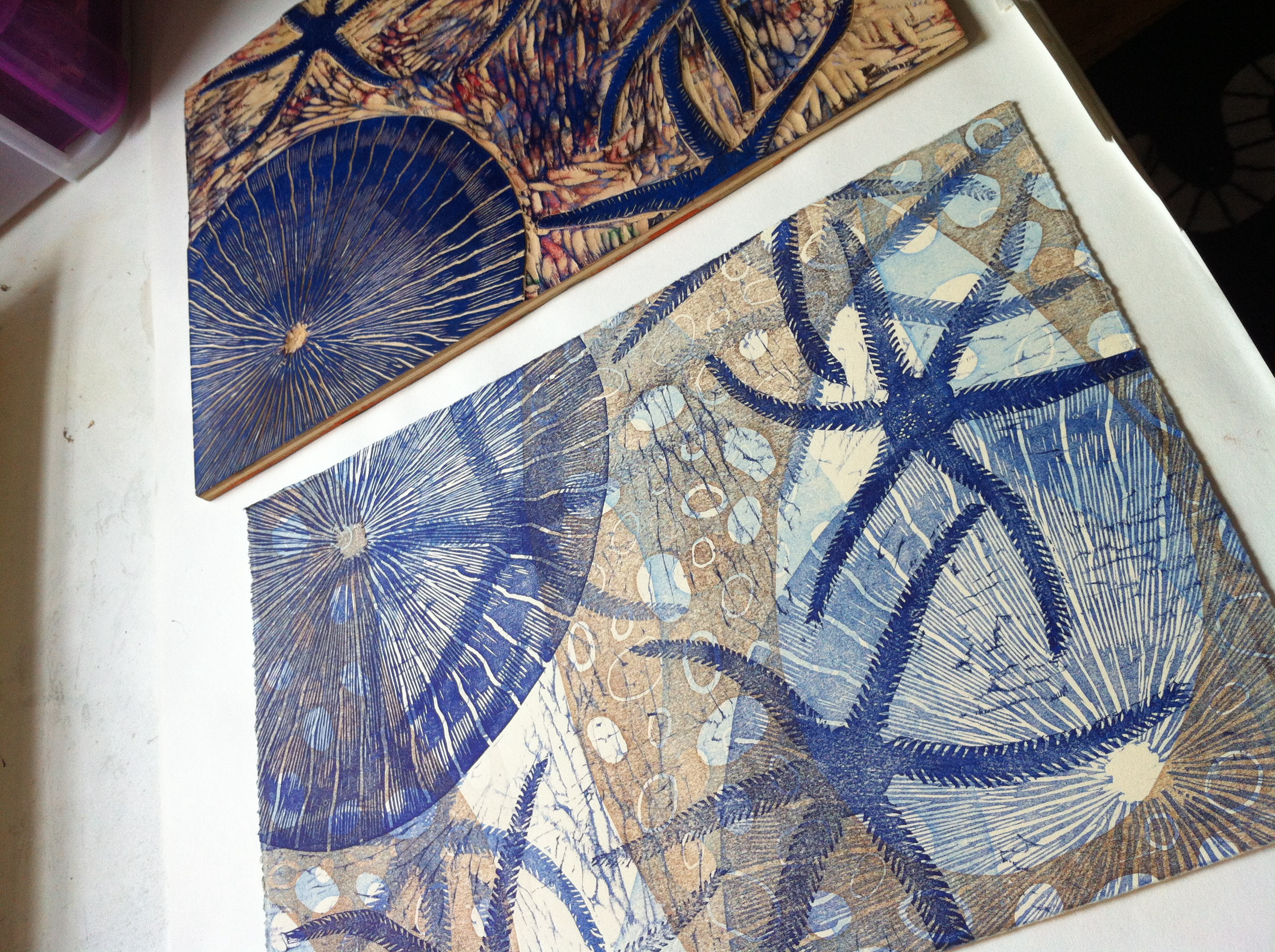 Original block print next to the carved woodblock used in the layers.