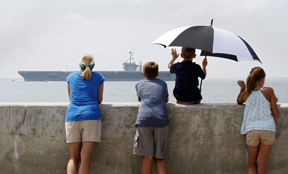 7/22/13 -- Visitors to Fort Monroe watch the USS Harry S. Truman as it departs on Monday.