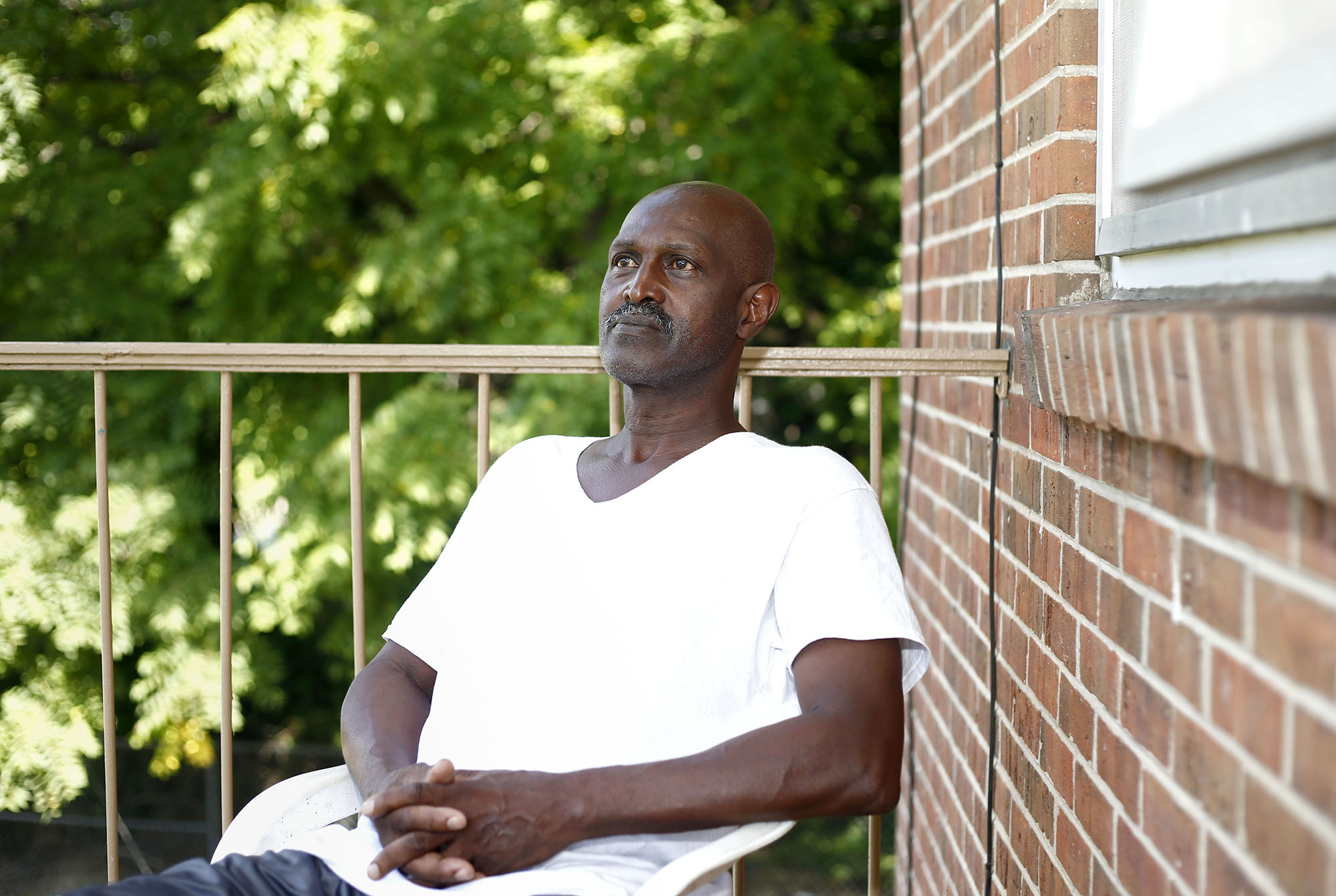 Nathaniel Bryant sits on the balcony of his home after having his voting rights restored by Gov. Terry McAuliffe, 43 years after becoming a convicted felon and losing his right to vote.