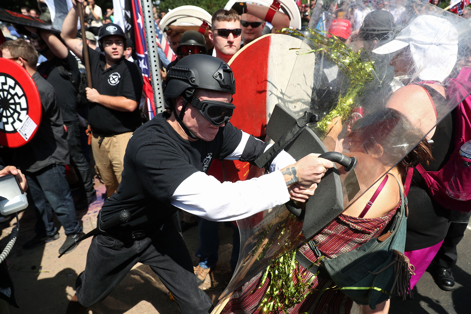 Alt-Right groups clash with counter-protesters outside Emancipation Park before the scheduled start of the Unite the Right rally in Charlottesville on Saturday, August 12, 2017.