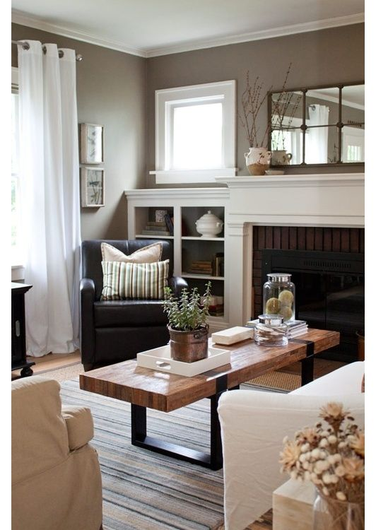 Traditional moldings, neutral colours with oak wood and Iron details.
