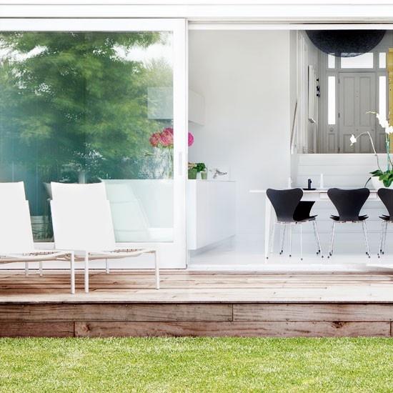 Retractable doors onto the patio and garden