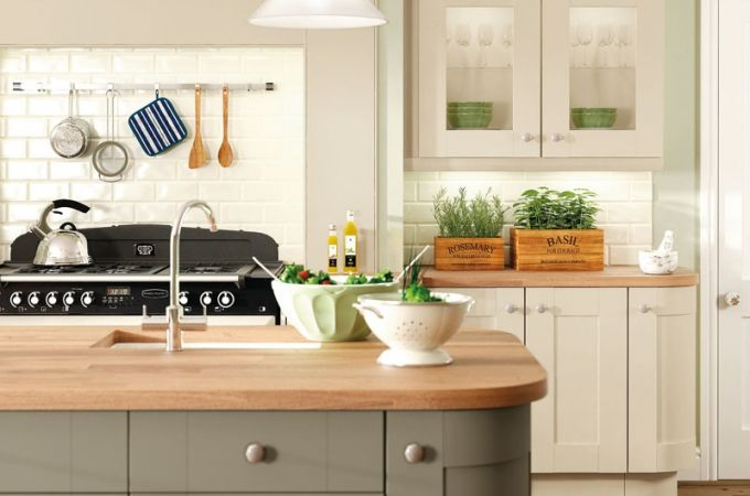 Sage and ivory contrast kitchen, fairly traditional with a modern twist to remain in-keeping with the exisitng house .