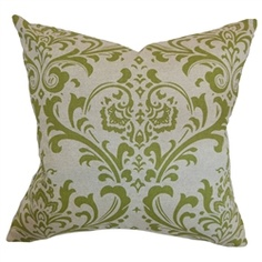 Green accents and damask prints.