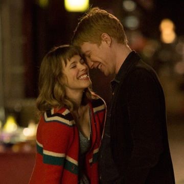 Rachel McAdams and Domhnall Gleeson in  About Time.  After holding this expression for three grueling months of shooting, both actors had to have their faces amputated.