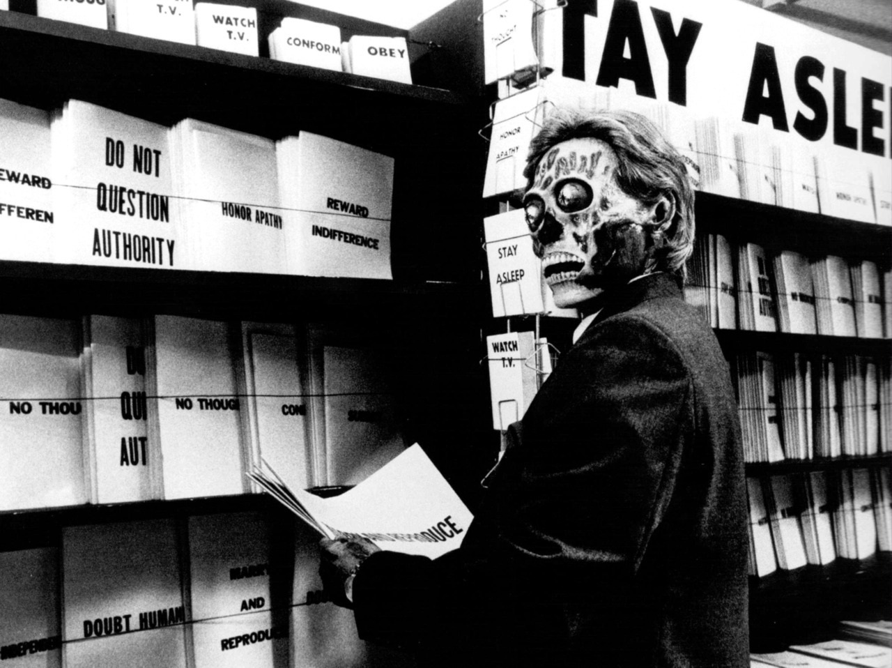 In  They Live,  special Wayfarers reveal the subtext of the industrialized world.