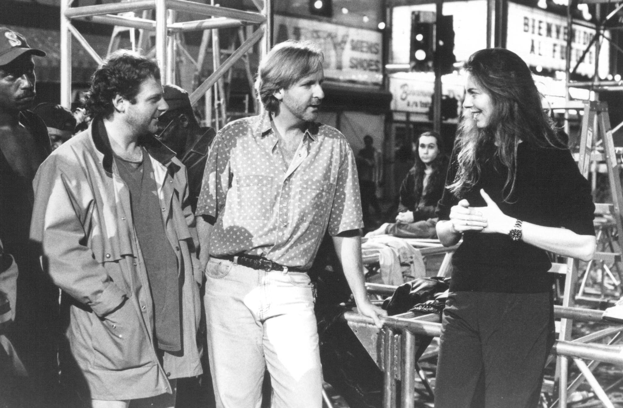 Writer/producer James Cameron confers with director (and ex-spouse) Kathryn Bigelow on the set of 1995's  Strange Days,  an ambitious cyberpunk flop.